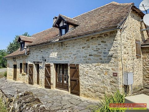 This typical stone Quercy farmhouse is full of original features with beams, evier sinks but is also modernised with a recently installed kitchen, two wood burning stoves in two living rooms, two bedrooms in the house with a bathroom. Annex to the si...